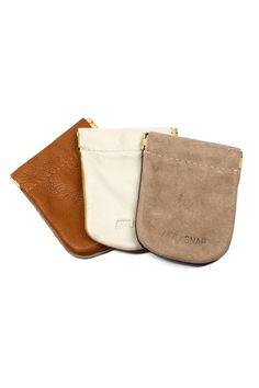 Awl Snap is a leather accessories line made in Virginia. She just came out with these snap coin pouches. Just pinch the corners to open it.