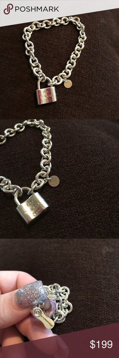 Tiffany and co locket bracelet sterling silver 925 Used but good condition still shinning beautifully. Tiffany and company bracelet. All sales final. Tiffany & Co. Jewelry Bracelets