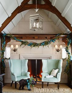 A swag of pheasant feathers, greens, and ribbon adorns the beams above this cozy fireplace sitting area. - Traditional Home ® / Photo: Werner Straube / Design: Design: Stephanie McKean for Nora C. Blue Christmas, Christmas Home, Whimsical Christmas, Christmas Design, Christmas Ideas, Christmas Wreaths, Real Estate Book, Tudor House, Tudor Cottage