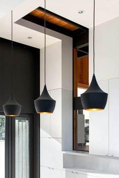 The kitchen faces an elevation, so keeping the space naturally lit was a challenge. The architects specified white surfacing to allow sunlight to bounce off the walls and penetrate the space.