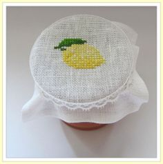 "Cross Stitch: Bonnet for selfmade lemon curd, designer unknown. Pattern approx. 1,4"" Ø."