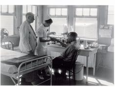 Vintage Photo - Doctor and nurse with patient