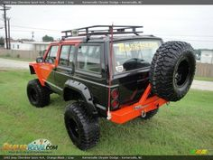 1992 Jeep Cherokee Sport 4x4 Orange/Black / Gray Photo #3