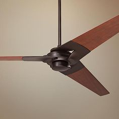 Finish off your living space with this dark bronze finish ceiling fan that comes with rich mahogany finish blades. This contemporary ceiling fan features a clean, linear body inspired by modern aerodynamics.
