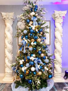 A Greek Christmas tree at the Swissotel Santa Suite. Blue Christmas Tree Decorations, Peacock Christmas Tree, Greek Christmas, Elegant Christmas Trees, Traditional Christmas Tree, Silver Christmas Tree, Christmas Mantels, Victorian Christmas, Christmas Christmas