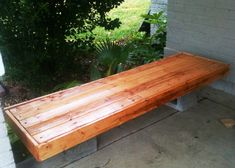 Simple bench from scrap lumber I made last week. Pecan stain. Cinder block base which I need to paint (along with my porch).