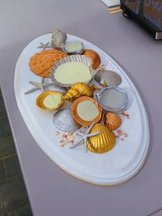 Another fabulous summer-inspired craft is to make beautiful shell candles.  I really love the way this centerpiece looks!  First gather clam shells or scallop shells and paint them with metallic paint.