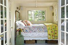 mirror headboard. tiny bedroom.