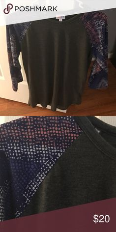 LuLaRoe Small Randy LLR Small Randy. Worn a handful of times, washed according to LLR standards. LOVE this one, but it's not the right size for me :( LuLaRoe Tops