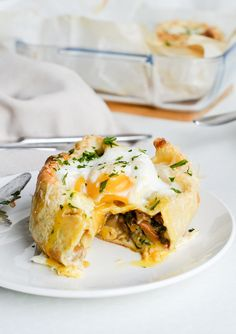 On top of a crepe filled with mushroom ragout. | 29 Ways To Eat Eggs For Every Meal