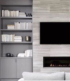 Need a living room makeover? Select a warm, muted and minimal material to tile your fireplace wall. You can't go wrong with the Flow collection (used in this image) which provides a calming yet elegant atmosphere to your room. Grey Fireplace, White Beige, Stone Tiles, Interior Walls, Getting Things Done, Minimalism, Hardwood, Flooring, Living Room