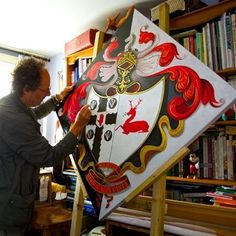 Suffolk based Heraldic Artist and Calligrapher David Truzzi-Franconi working on a hatchment for (I think) one of the Fletcher baronets; maybe of Clea Hall. The impalement may be Bowen. Medieval Shields, Baronet, Princess Outfits, Catholic Art, Ex Libris, Crests, Coat Of Arms, Funeral, Knight