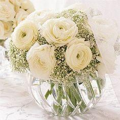 Wedding Flower Arrangements White Winter Wedding Flower Ideas : Wedding Flowers Gallery - Soft and white, this simple arrangement of white ranunculus and gypsophila sits in a cut crystal bowl. Karen Bussen From SIMPLE STUNNING WEDDING FLOWERS by Karen.