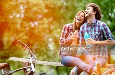 Young Cheerful Couple Drinking Water After Riding Bicycles. : Photo