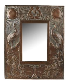 SCOTTISH SCHOOL  COPPER WALL MIRROR, CIRCA 1920  the rectangular frame repoussé decorated with opposed suns and peacocks on a hammered ground and enclosing a bevelled mirror plate  50.5cm x 40cm