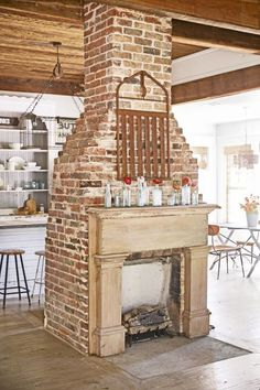 "See How a Run-Down Texas Farmhouse Became This Family's Country Dream: ""We tore everything out and found this beautiful brick fireplace beneath all the junk."""