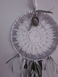 A vintage lace doily dream catcher in white and gray with a gorgeous glass chandelier hanger --- A delicate vintage dream catcher