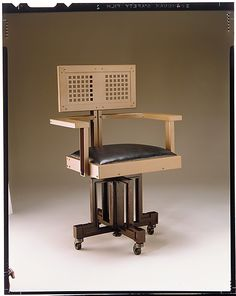Revolving Armchair 1904. Steel and wood.  Frank Lloyd Wright