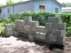 Cinder block planter wall... doesn't look like much now but imagine the possibilities!
