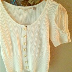 Knitted and Knotted top. Detailed lace sleeves and 100% cotton top. The fit is small for a medium and the bottom of the shirt stops just below the belly button. Knitted and Knotted Tops Blouses