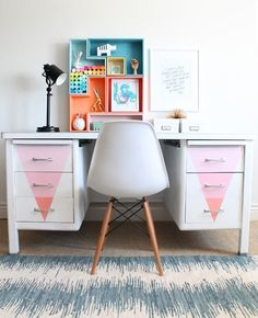 While this original #DIY dorm decor idea calls for revamping a plain desk with matte-finish paint, you can get a similar effect — at least for the ombré triangles on the drawer fronts — with a few lengths of removable contact paper.