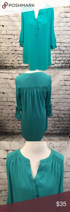 """Daniel Rainn Teal Turquoise Chiffon Shirt Dress Beautiful Teal / Turquoise shirt dress by Daniel Rainn. Features 3/4 tab roll sleeves. Fully lined. Features hidden buttons down the front. Armpit to armpit measures 20"""" and length is approx 36"""" at longest point. Daniel Rainn Dresses"""