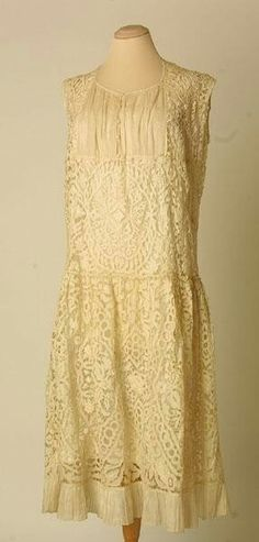 Dress made of cream cotton using both openwork and machine. Machine part made using the Carrickmacross technique. 1926.