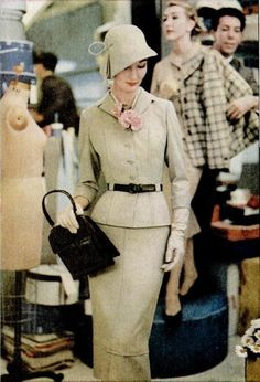 1957 woman's fashion, beige suit with millinery flower, 1950's fashion
