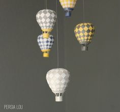 I have been wanting to try to make the beautiful woven paper hot air balloons from PaperMatrix for a long time now, and finishing up the nursery gave me the motivation to give it a shot. PaperMatri…