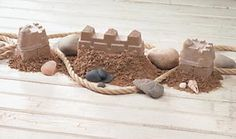 Making Homemade Sand Castles  These cute sand castles remain intact indefinitely. Use them as a table topper at home or for a beach picnic table centerpiece.