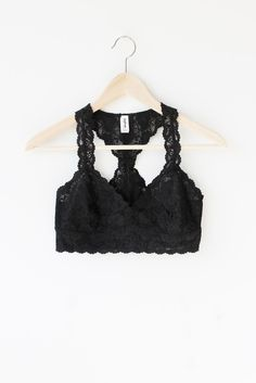 """Details Size Shipping • 90% Nylon 10% Spandex • Scalloped racer back bralette • Hand Wash • Line dry • Imported • Measured from small • Length 11.5"""" • Chest 12."""