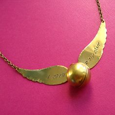 harry potter snitch necklace - looks like mine from my future sister :) thanks camille!