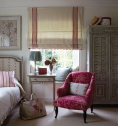 Ivy Clad: Perfect English - Another mix of patterns: 'Pandora' on chair, 'Cameo Rose' chair cushion and headboard upholstery. 'Red Ticking' appears to have been combined with a plain linen for a creative and attractive window shade.