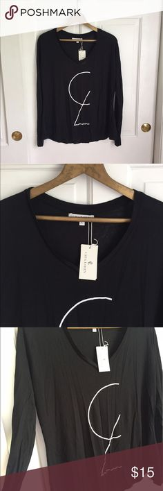 Cara Loren Long Sleeve Top Cara Loren Long Sleeve Top size Large. NWT, very soft just too small for me. 100% Modal Tops Tees - Long Sleeve