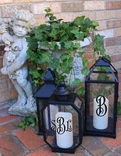 outdoor lanterns - how easy to throw a monogram on a Hobby Lobby one!