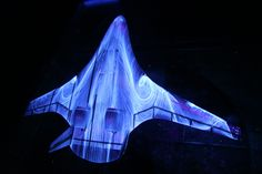 """NASA Gov Doc: """"Glow with the Flow"""" In this photo, engineers NASA's Langley Research Center have sprayed fluorescent oil on a percent scale model of a futuristic hybrid wing body during tests in the 14 Subsonic Wind Tunnel. Nasa Langley, Psychedelic Space, Wind Tunnel, Nasa Images, Experimental Aircraft, Wings Design, Aircraft Design, Image Of The Day, Pictures Of The Week"""