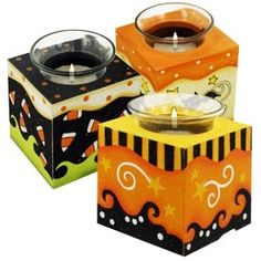 Halloween candle holder..use wooden blocks from Michaels and cover in scrapbook halloween paper...could do for any holiday really...