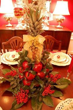 beautiful centerpiece with apples, pineapple and berries