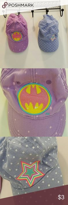 Toddler Ballcap Bundle Both purchased from Target The light purple has a batman symbol and is sparkly. I'd say it's slightly larger than the other hat. There are speckled bleach stains on it. No clue how it happened but they look like they're just part of the style The blue polka dot has a sparkly star and is slightly smaller. Both hats fit my daughter up to 18m Target Accessories Hats