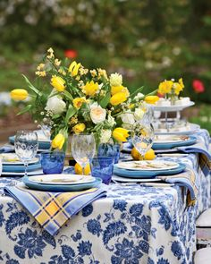Splashes of yellow in the way of lemons and lively tulips perk up this blue-and-white table set in the garden. See more of our favorite ways to decorate with Classic Blue, Pantone's color pick for White Table Settings, Beautiful Table Settings, Outdoor Table Settings, Place Settings, Outdoor Dining, Yellow Table, Southern Ladies, White Decor, Vignettes