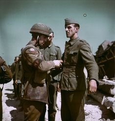 A Canadian MP searching a German POW, June 1944