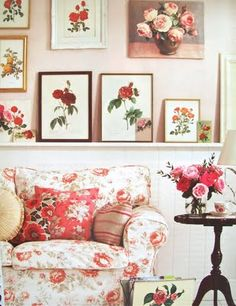 Oh my! Pink rose pictures, sofa,pillow, and fresh arrangement.  Love the wall!