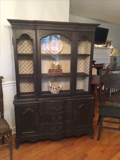 Vintage china cabinet painted in graphite and then sealed with dark wax inside painted in old white