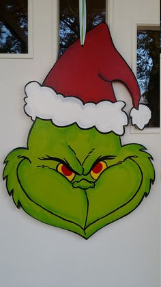 The Grinch door hang by DecadentDoorsbyMandy on Etsy