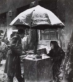 Vintage Work: A street vendor selling their wares on a bitter winter morning. Kraków, Poland. Circa 1930s. Photo Credit: Roman Vishniac