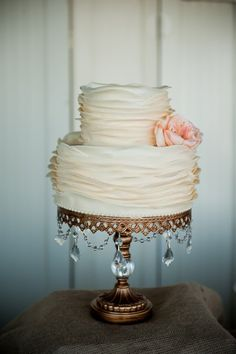 Keep your cake itself simple and place it on a decorate or elaborate stand for a stunning look for less!
