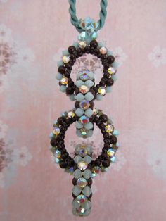 Joined in a row! Maroon Swarovski Pearls, Mint Alabaster, Mint Alabaster ABX2, and the new Chrysolite Opal Bicones, Crystal AB Roses Montees in gold settings. Created March 2011