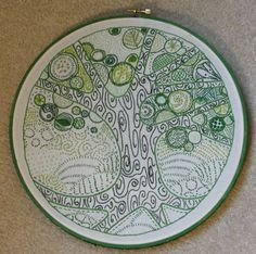 The free form doodling in this embroidery is so beautiful and intricate.#craftster