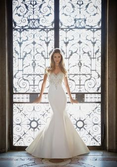 Crystallized embroidery decorates this sweetheart double off the shoulder neckline on a duchess satin mermaid gown. Colors Available: White/Silver, Ivory/Silver (Shown)