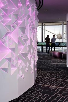 A close-up shot of the 40' long Illuminated Core Wall, installed in Dallas' Reunion Tower. The color-changing wall was fabricated from over 1000 pyramids in different sizes--composing both negative and positive space.